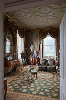 The boudoir is a frenzy of needlepoint and rococo revival, every surface covered in a woven or plastered pattern