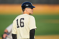 Wake Forest Demon Deacons head coach Tom Walter (16) coaches third base during the game against the Marshall Thundering Herd at Wake Forest Baseball Park on February 17, 2014 in Winston-Salem, North Carolina.  The Demon Deacons defeated the Thundering Herd 4-3.  (Brian Westerholt/Four Seam Images)