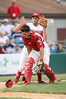 July 4th 2008:  Third baseman Cody Overbeck (31) and catcher Travis d'Arnaud (15) of the Williamsport Crosscutters, Class-A affiliate of the Philadelphia Phillies, collide on a play during a game at Bowman Field in Williamsport, PA.  Photo by:  Mike Janes/Four Seam Images