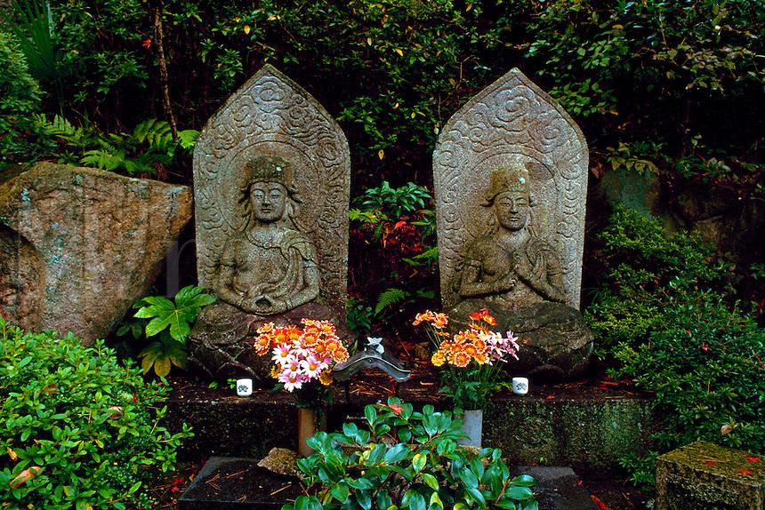 Stone sculpture of Buddhist images in temple garden, Mitakidera, Hiroshima, Japan