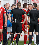 Mark Warburton and Jim Stewart confront referee John Beaton on the pitch at full-time