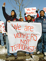 """An immigrant protester leonardo Salazar, left, and Eaulojea Martinez, center, and the man at right is unidentified, demonstrate some at  a rally supporting a work stoppage Tuesday, Feb. 14, 2006 at Independence Mall in Philadelphia. The event titled """"A Day without an Immigrant"""" is to urge employers to oppose pending legislation in Washington that would make illegal immigration a felony and would prosecute those who hire or aid unlawful immigrants. (Bloomberg News/Bradley C Bower)"""
