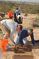 Damian Greenwell (left) a ua senior.and volunteer Peter Jones  dig dirt.to be screened of dirt from.the Marana Platform mound looking for.shards and other artifacts from the .mound occupied for 100 years by the HoHoKam.people from 1200 ad to 1300 ad...