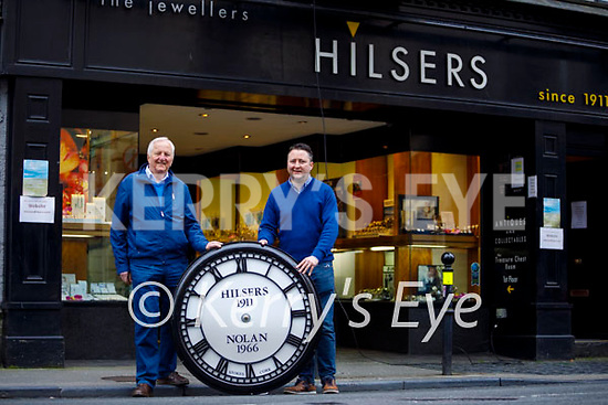 Billy and Will Nolan standing with the clock before its been reinstated at Hilsers/Nolan Jewellers on Sunday morning.