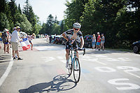 Michał Gołaś (POL/Omega Pharma-Quickstep) trying to keep his legs cool with bottles by fans up the final climb to Chamrousse (1730m/18.2km/7.3%) in +35°C<br /> <br /> 2014 Tour de France<br /> stage 13: Saint-Etiènne - Chamrousse (197km)