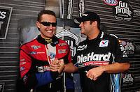 Nov. 13, 2011; Pomona, CA, USA; NHRA funny car driver Matt Hagan (right) and Bob Tasca III during the Auto Club Finals at Auto Club Raceway at Pomona. Mandatory Credit: Mark J. Rebilas-.