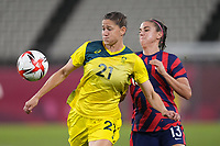 KASHIMA, JAPAN - AUGUST 5: Laura Brock #21 of Australia battles for the ball with Alex Morgan #13 of the United States during a game between Australia and USWNT at Kashima Soccer Stadium on August 5, 2021 in Kashima, Japan.