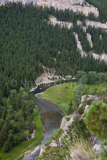A raft of fishermen on the Smith River in Montana wind their way through the canyons and forests