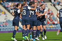 Glasgow, Scotland - July 25, 2012: The US women's national soccer team celebrates Abby Wambach's goal.