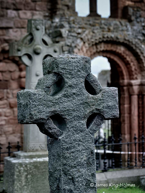 Old Celtic cross in the grounds of Lindisfarne Priory. Northumberland