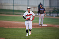 Great Falls Voyagers first baseman Harvin Mendoza (17) jogs off the field between innings of a Pioneer League game against the Missoula Osprey at Centene Stadium at Legion Park on August 19, 2019 in Great Falls, Montana. Missoula defeated Great Falls 1-0 in the second game of a doubleheader. (Zachary Lucy/Four Seam Images)
