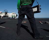 120215-N-DR144-280 ARABIAN SEA (Feb. 15, 2012) Aviation Boatswain's Mate (Equipment) Airman Brad Thomas stands by with an aircraft weight board as a C-2A Greyhound is prepared for launch from the bow catapults on the flight deck of the Nimitz-class aircraft carrier USS Carl Vinson (CVN 70). Carl Vinson and Carrier Air Wing (CVW) 17 are deployed to the U.S. 5th Fleet area of responsibility.  (U.S. Navy photo by Mass Communication Specialist 2nd Class James R. Evans/Released).