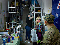Natalia Voronkova and a colleague prepare a bag of items for a visiting soldier in the main office and store of her organisation that supports soldiers fighting Russian-backed separatists in the east of the country. The soldier was wounded, but has now recovered, and is receiving food and home supplies.