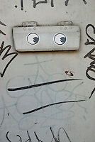 Graffiti and Eye Stickers on a Doorway Mail Slot, Lower East Side, New York City, New York State, USA