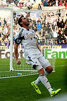 Saturday 19 October 2013 Pictured: Angel Rangel celebrates <br /> Re: Barclays Premier League Swansea City vSunderland at the Liberty Stadium, Swansea, Wales