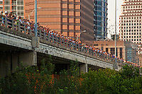 Large groups of people gather to see the world's largest urban Mexican free-tailed bat colony emerge from under the Congress Avenue Bridge in Austin, Texas.
