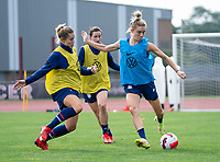 CLEVELAND, OH - SEPTEMBER 14: Abby Dahlkemper defends Kristie Mewis of the United States during a training session at the training fields on September 14, 2021 in Cleveland, Ohio.
