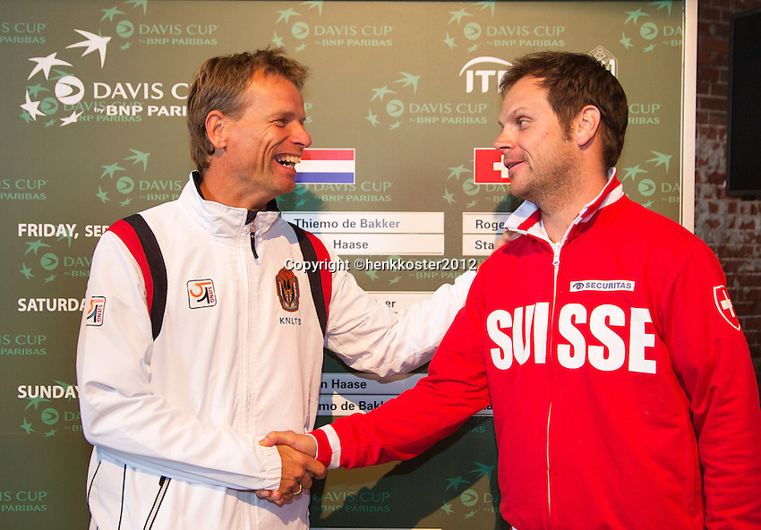 13-09-12, Netherlands, Amsterdam, Tennis, Daviscup Netherlands-Swiss, Draw , captains Jan Siemerink(L) and Severin Luthi.