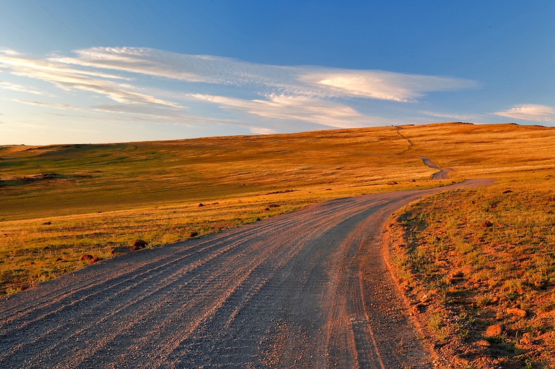 Gravel road at sunset. Steens Mountain. Oregon