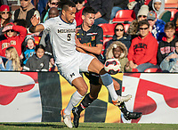 COLLEGE PARK, MD - NOVEMBER 03: Justin Harris #20 of Maryland battles for the ball with Abdou Samake #5 of Michigan of Michigan during a game between Michigan and Maryland at Ludwig Field on November 03, 2019 in College Park, Maryland.