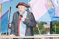John Hugo, the alt-right leader of the organization Super Happy Fun America, wears a three-corner hat, tie featuring an outline of the United States, American flag pin, and a Straight Pride button, as the group demonstrates against facemasks, vaccines, and pandemic closures, and in support of the reelection of President Donald J. Trump near the residence of Massachusetts governor Charlie Baker in Swampscott, Massachusetts, on Sat., Sept. 26, 2020. Super Happy Fun America is most well known for organizing the Straight Pride Parade in Boston on August 31, 2019.