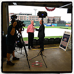 WSPA-TV sports director Pete Yanity interviews Greenville Drive president Craig Brown after Tuesday's Opening Day was rained out. The new opener will be Wednesday, May 5, 2021, with a doubleheader Thursday. (Tom Priddy/Four Seam Images)