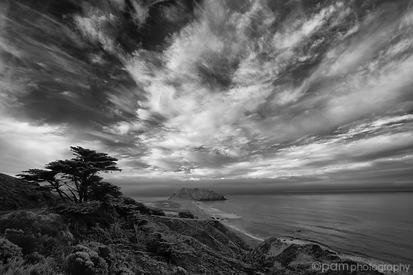 Black and white image of dramatic clouds over Big Sur's Point Sur lighthouse
