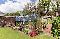 BNPS.co.uk (01202) 558833. <br /> Pic: SandersonYoung/BNPS<br /> <br /> The greenhouse in the large garden.<br /> <br /> A quirky 'show home' for a brickwork owner where Lewis Carroll is believed to have stayed while writing some of his Alice in Wonderland books is on the market for just under £1m.<br /> <br /> Red Cottage is a striking Grade II listed property in Whitburn, Tyne and Wear, where Charles Dodgson, otherwise known as Lewis Carroll, regularly visited family.<br /> <br /> The unusual 179-year-old home was built to show off as many design features as possible, and has a walled garden and even an air raid shelter.