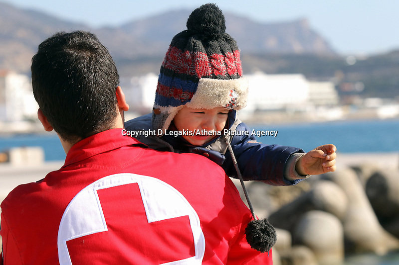 Pictured: A young child is crying as she is helped to safety by a member of the emergency services Thursday 27 November 2014<br /> Re: One of the largest refugee boats in recent months has disembarked refugees in Ierapetra, Crete. The freighter Baris, carrying 700 people thought to be from Syria and Afghanistan, is being towed by a Greek frigate.<br /> Officials and Red Cross volunteers prepared an indoor basketball stadium as interim shelter in the southern Cretan port town of Ierapetra on Wednesday ahead of the migrants' expected arrival.<br /> Greek officials said the Baris, which lost propulsion on Tuesday, was being towed slowly in poor sea conditions and would arrive after nightfall, probably early Thursday.<br /> They said it was unclear which Mediterranean location had been the departure point for the 77-meter (254-foot) vessel, which was sailing under the flag of the Pacific nation of Kiribati.