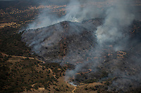 Aerial image a forest fire in El ronquillo, near Sevilla on July 26, 2015. Firefighters of Brica´s Malaga 703 of the service of andalucian Infoca plan work in the wildfire in El Ronquillo, near Sevilla on July 26, 2015.<br /> Since July 19 wildfires have ravaged nearly 39,000 hectares of land in Spain, according to the provisional figures from the agriculture ministry. © Pedro ARMESTRE