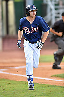 Elizabethton Twins designated hitter Colton Burns (23) runs to first base during a game against the Kingsport Mets at Joe O'Brien Field on August 7, 2018 in Elizabethton, Tennessee. The Twins defeated the Mets 16-10. (Tony Farlow/Four Seam Images)