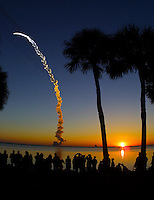 Spectators line the banks of the Banana River to watch as Space Shuttle Discovery lifts off at sunrise to begin the STS 102 Mission, Kennedy Space Center, Titiusville, FL,  March 2001.  (Photo by Brian Cleary/www.bcpix.com)