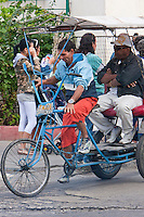 """Cuba, Havana.  Man-powered Bicycle-Taxis (""""Bicitaxis"""") provide a cheap form of transportation in urban Havana."""
