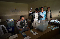 Voting gets underway in Jalalabad city, capital of Nangarhar province in Afghanistan for the presidential elections. 5-4-14 Election workers show presidential election votes to monitors and observers as they count them in the Abdul Wakil High School Polling station in Jalalabad.