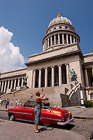 The Capital with car and tourist