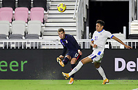 FORT LAUDERDALE, FL - DECEMBER 09: Chris Mueller #11 of the United States sends a cross ball into the box during a game between El Salvador and USMNT at Inter Miami CF Stadium on December 09, 2020 in Fort Lauderdale, Florida.
