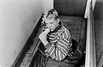 Drugs UK 1980s. Drug addict glue sniffing teenager sleeping rough on street central London doorway 80s England 1983