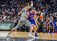 WASHINGTON, DC - DECEMBER 28: Mark Gasperini #23 of American barrels past Omer Yurtseven #44 of Georgetown. during a game between American University and Georgetown University at Capital One Arena on December 28, 2019 in Washington, DC.