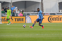Commerce City, CO - Saturday July 20, 2019: New York City defender Sebastien Ibeagha #33 passes the ball. The Colorado Rapids lost to the New York FC by a score of 1 to 2 during a Major League Soccer (MLS) game at Dick's Sporting Goods Park (DSGP).