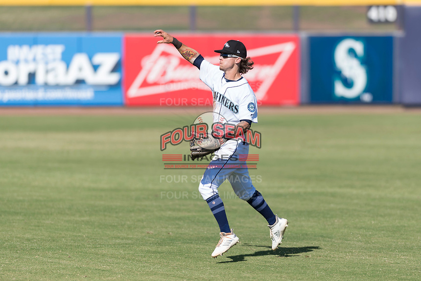 Peoria Javelinas right fielder Ian Miller (9), of the Seattle Mariners organization, throws to the infield during an Arizona Fall League game against the Glendale Desert Dogs at Peoria Sports Complex on October 22, 2018 in Peoria, Arizona. Glendale defeated Peoria 6-2. (Zachary Lucy/Four Seam Images)