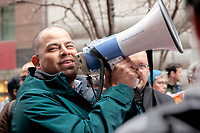 A large crowd gathered at the James R. Thompson Center in downtown Chicago to rally against President Trumps. declaration of a national emergency at the nation's southern border. Numerous Latinx politicians were present to speak out against what they called a racist injustice. r Hispanic Politicians Giving Speeches at Various Events