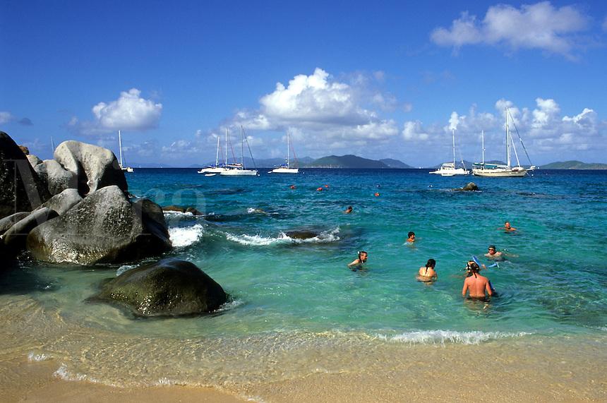 Beautiful rock formation boulder rocks with with snorklers in ocean at The Baths of Virgin Gorda in British Virgin Islands