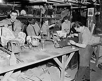 Reparateurs de jouets, <br /> Novermbre 1961<br /> (date exacte inconnue)<br /> <br /> PHOTO  : Agence Quebec Presse - Photo Moderne