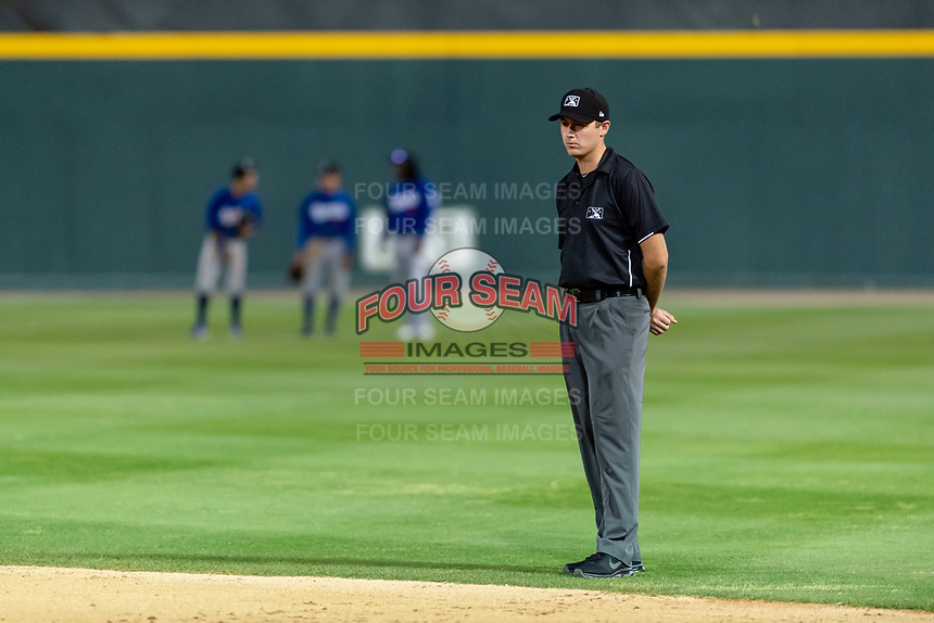 Field umpire Trevor Dannegger during a California League game between the Visalia Rawhide and the Rancho Cucamonga Quakes at Rawhide Ballpark on April 8, 2019 in Visalia, California. Rancho Cucamonga defeated Visalia 4-1. (Zachary Lucy/Four Seam Images)