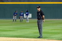 Field umpire Trevor Dannegger during a California League game between the Visalia Rawhide and the Rancho Cucamonga Quakes at Rawhide Ballpark on April 8, 2019 in Visalia, California. Rancho Cucamonga defeated Visalia 4-1. (Zachary Lucy/Four Seam Images)