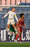 USA defender (3) Christie Rampone heads the ball away from China forward (9) Han Duan during the Four Nations Tournament in  Guangzhou, China on January 20, 2008. The U.S. defeated China, 1-0, to win the tournament.