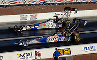 Apr 7, 2006; Las Vegas, NV, USA; NHRA Top Fuel driver Larry Dixon in the Miller Lite dragster leads Melanie Troxel in the Skull Gear/Torco Race Fuels dragster during qualifying for the Summitracing.com Nationals at Las Vegas Motor Speedway in Las Vegas, NV. Mandatory Credit: Mark J. Rebilas