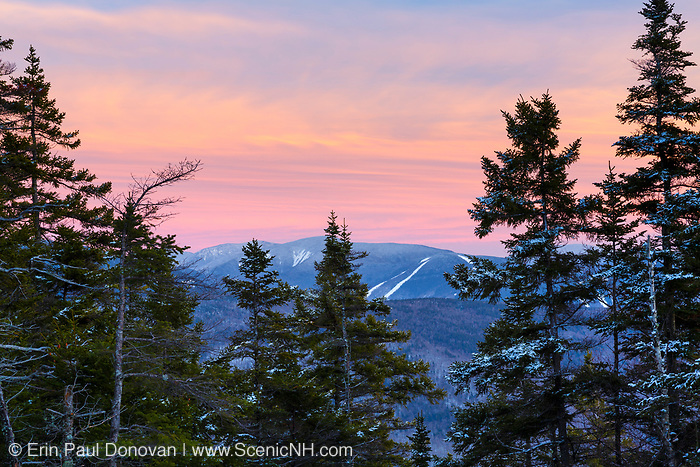 Franconia Notch State Park - Loon Mountain at sunset from the summit of Mount Pemigewasset in Lincoln, New Hampshire during the winter months.