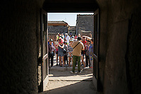 A tourist group waits to make its way into the thermal baths on Friday, Sept. 18, 2015, in Pompeii, Italy. The city of Pompeii was destroyed when nearby Mount Vesuvius erupted on August 24, AD 79. The town and its residents were buried and forgotten until the ruins were discovered and eventually excavated hundreds of years later. The ruins are one of Italy's top tourist attractions today. (Photo by James Brosher)