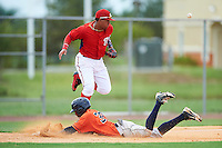 GCL Nationals third baseman Anderson Franco (11) can not come up with a throw as Wilson Amador (39) slides into third base during a game against the GCL Astros on August 14, 2016 at the Carl Barger Baseball Complex in Viera, Florida.  GCL Nationals defeated GCL Astros 8-6.  (Mike Janes/Four Seam Images)